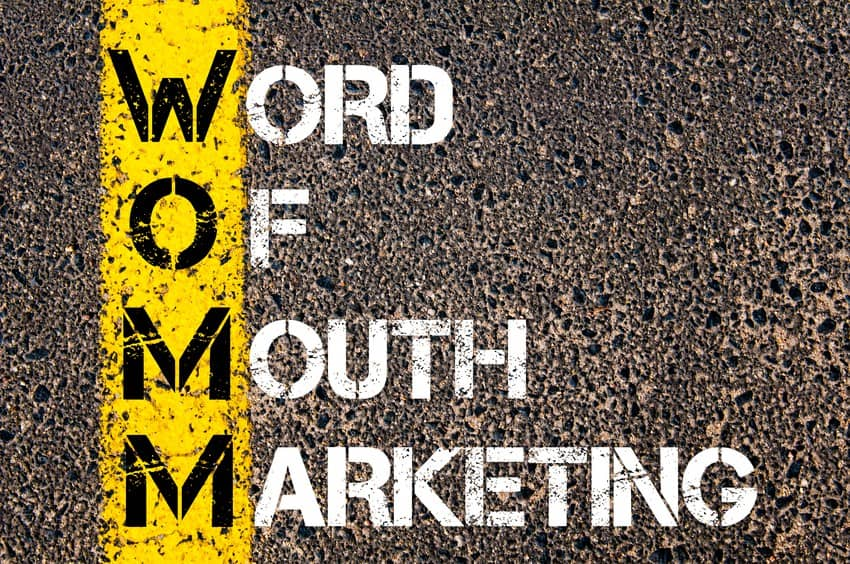 word of mouth marketing written on asphault street