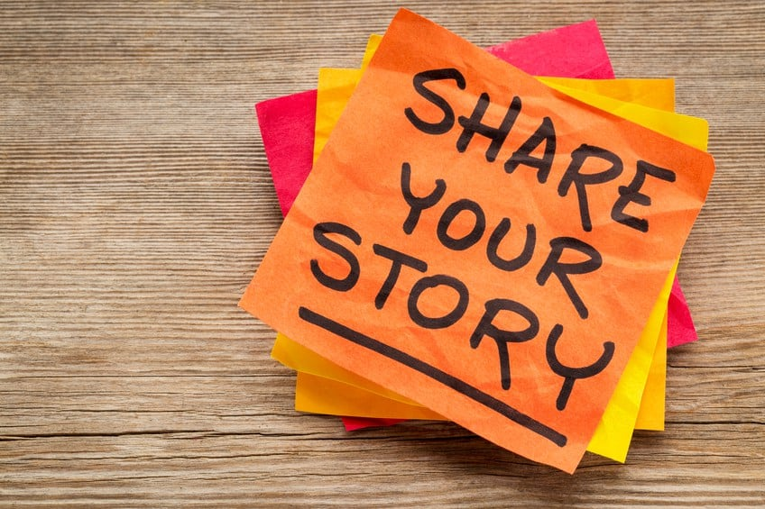 """sticky note that says """"share your story"""""""