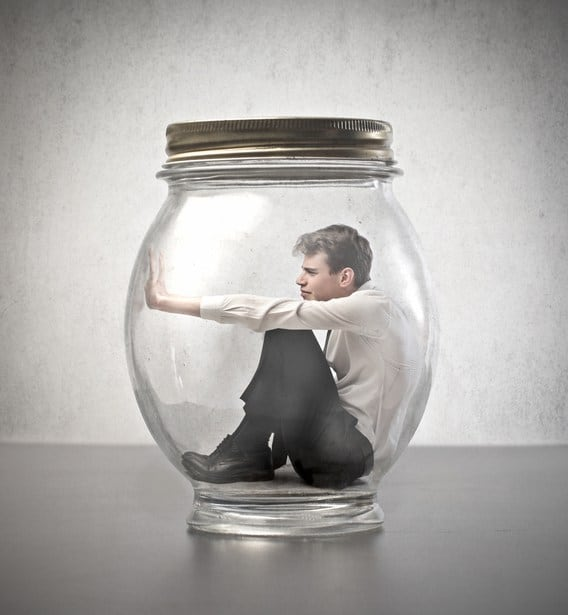 man trapped in glass jar with lid