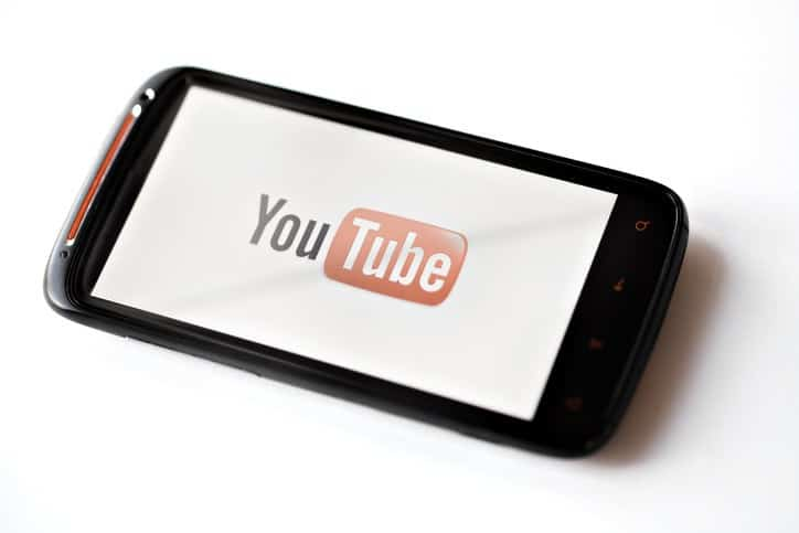 smart phone with youtube logo showing