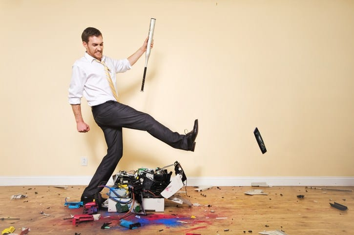 man stomping on broken electronics