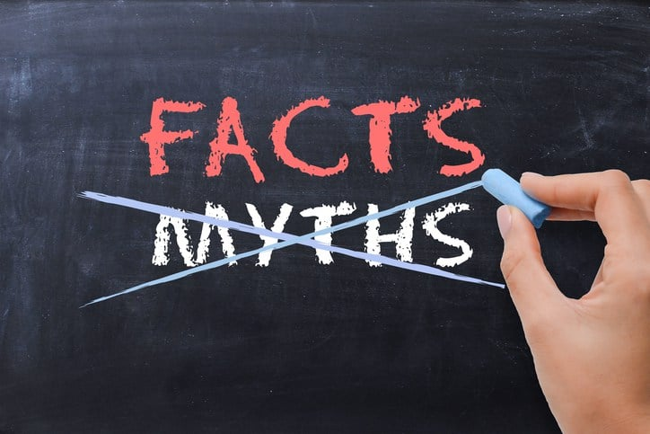 chalkboard words facts with myths marked through