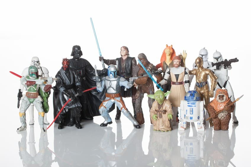 an assortment of star wars characters standing together with weapons drawn