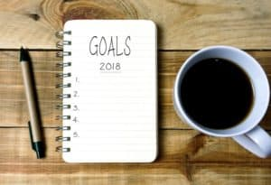 writing tablet with 2018 goals written
