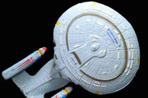 close up photo of a toy uss enterprise from star trek show