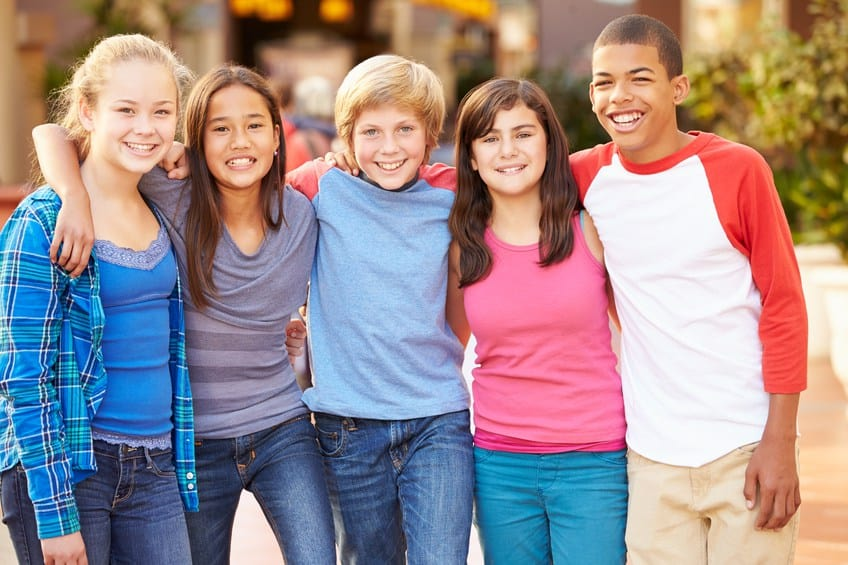 photo of five smiling tweens preteens and teenagers