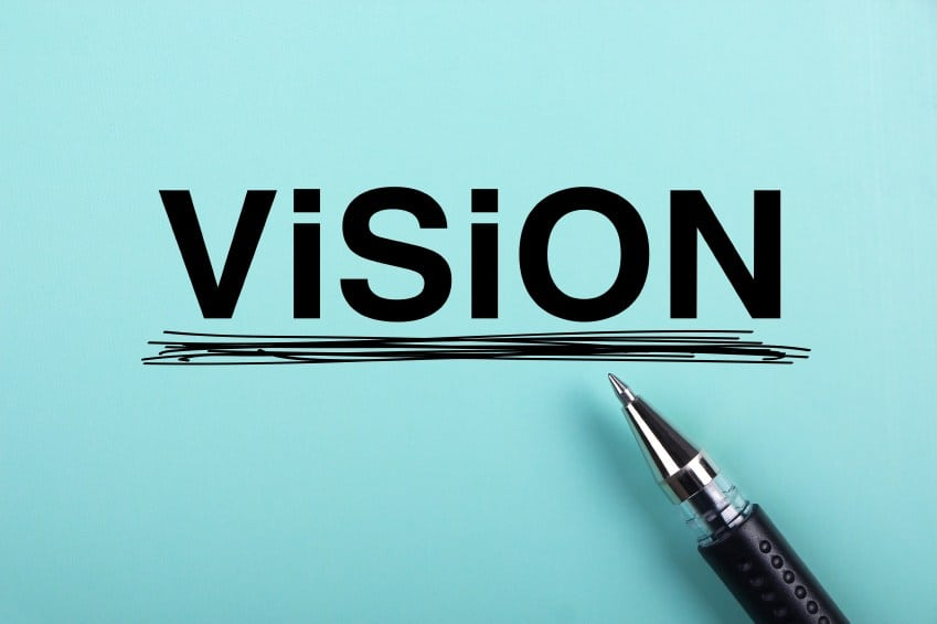 close up of ballpoint pen underlining the word vision